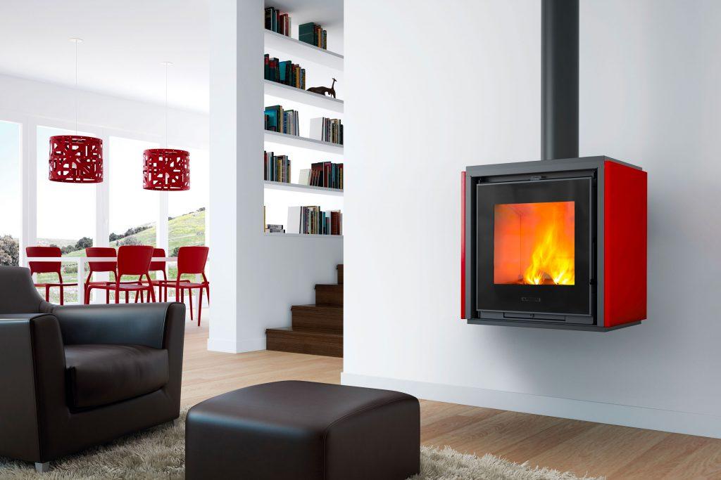 Piazzetta's QUBE 1 model wood stove with Rosso Lava Majolica cladding.